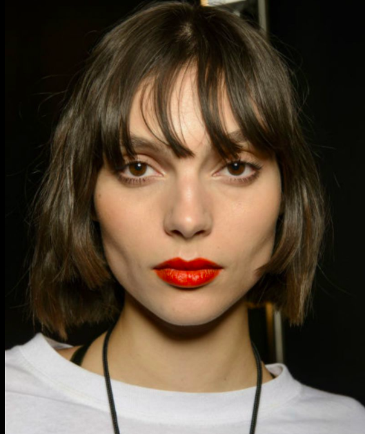 Freshen up a bob with a long, grown out fringe.