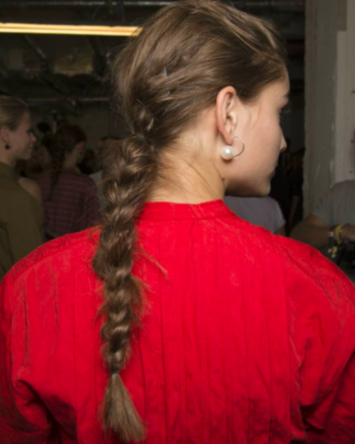 The messy plait is not only easy to do but is a quick way to not look to 'done'.