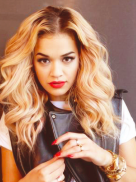 Singer Rita Ora makes sure she uses a heat spray before styling her curly hair.