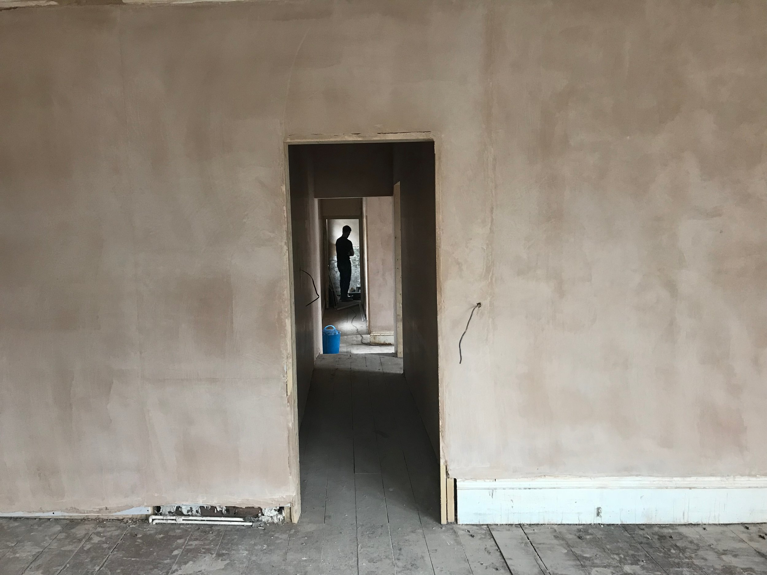 The silhouette of David down a freshly plastered corridor!