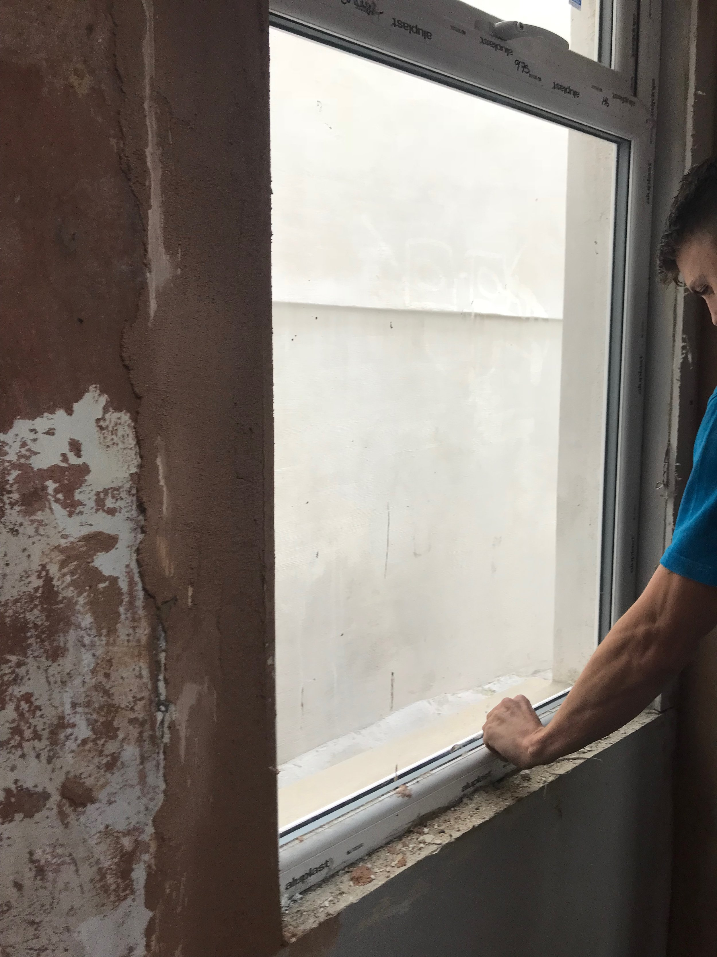 ben inspecting the new windows fitted at a property in South Wales.