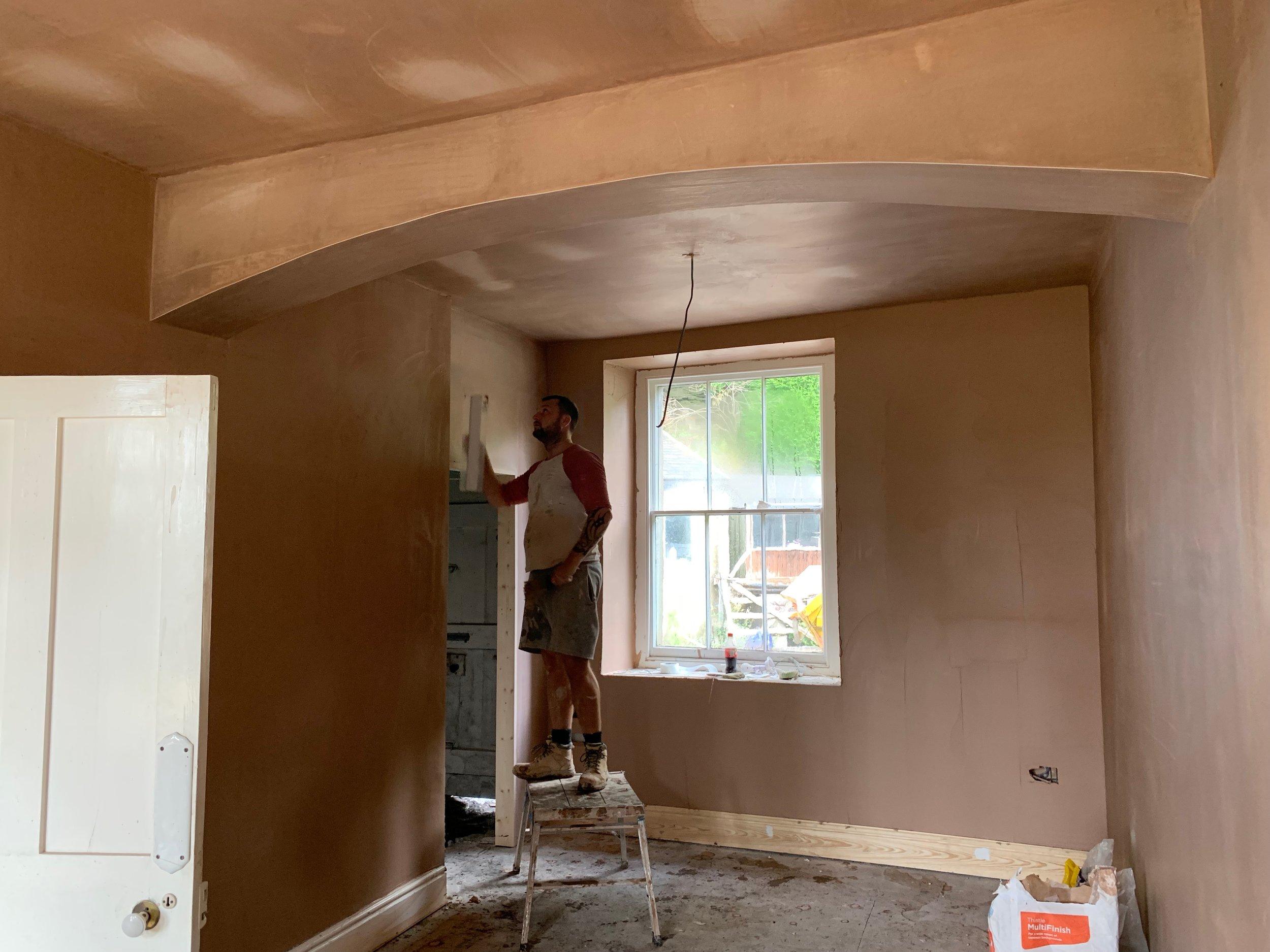 Plasterers finishing off reception room