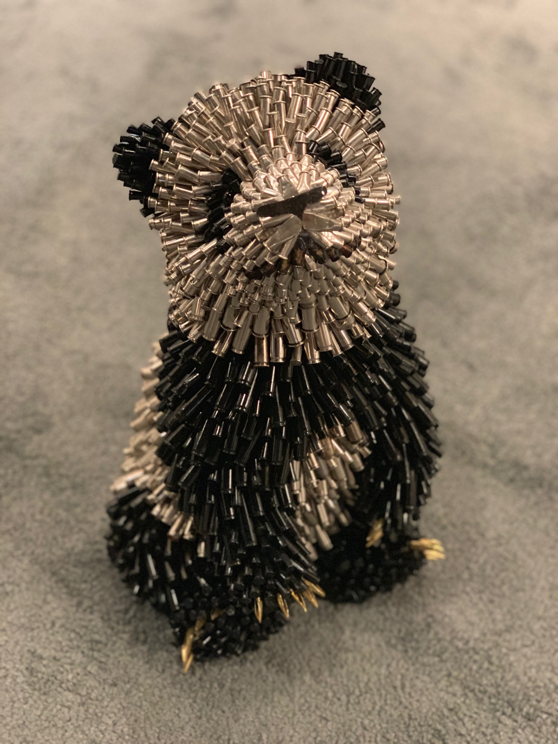 Federico Uribe (Colombian, b. 1962)   Baby Panda (Patient) , 2019  Bullet Shells 15 x 11 x 9 in. (38.1 x 27.9 x 22.9 cm)  ACPB0361