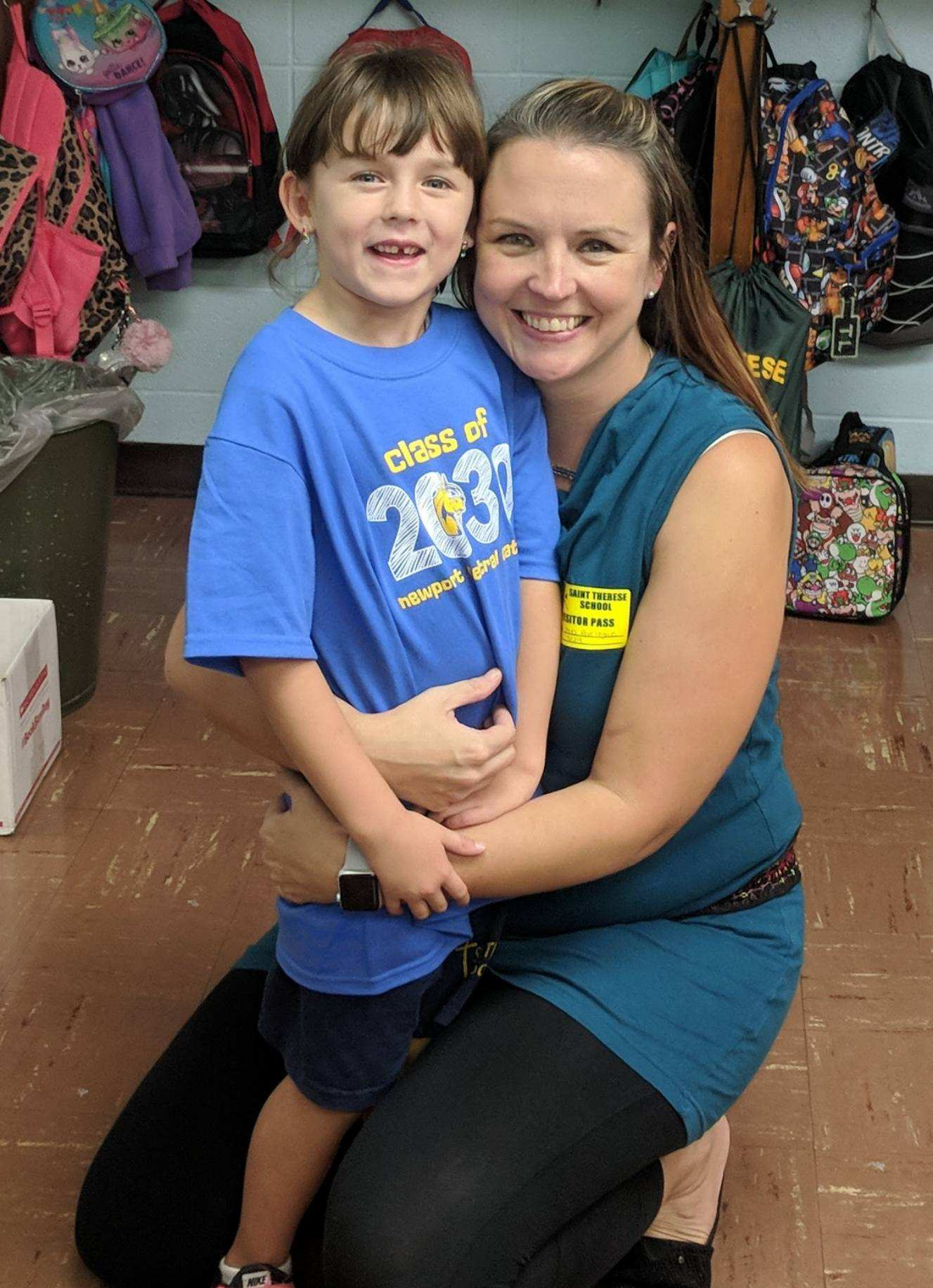 Mrs. Jill Aseltyne, Teacher at NCC and her daughter Bailey, first grader at St. Therese School share a special moment.