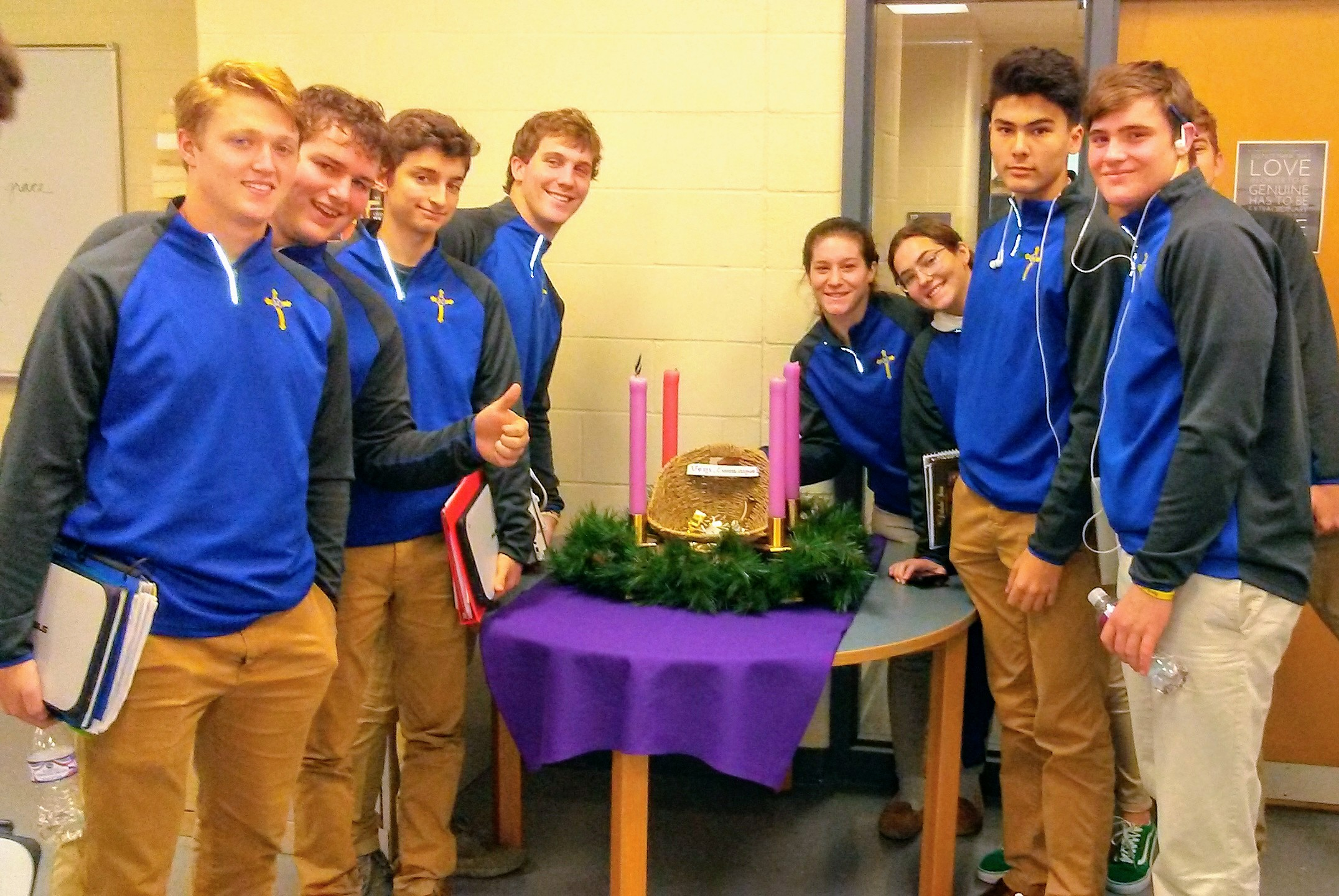 Some of our Senior students gather around the Advent wreath. They have the opportunity to place their Prayer, Fasting & Almsgiving resolutions in the manger.