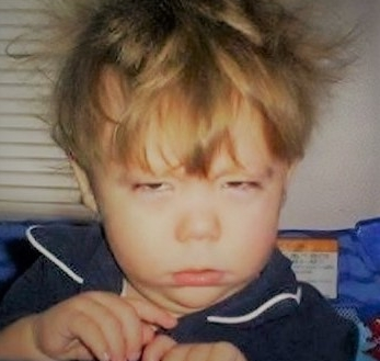 sleepy-kid-bed-head.jpg