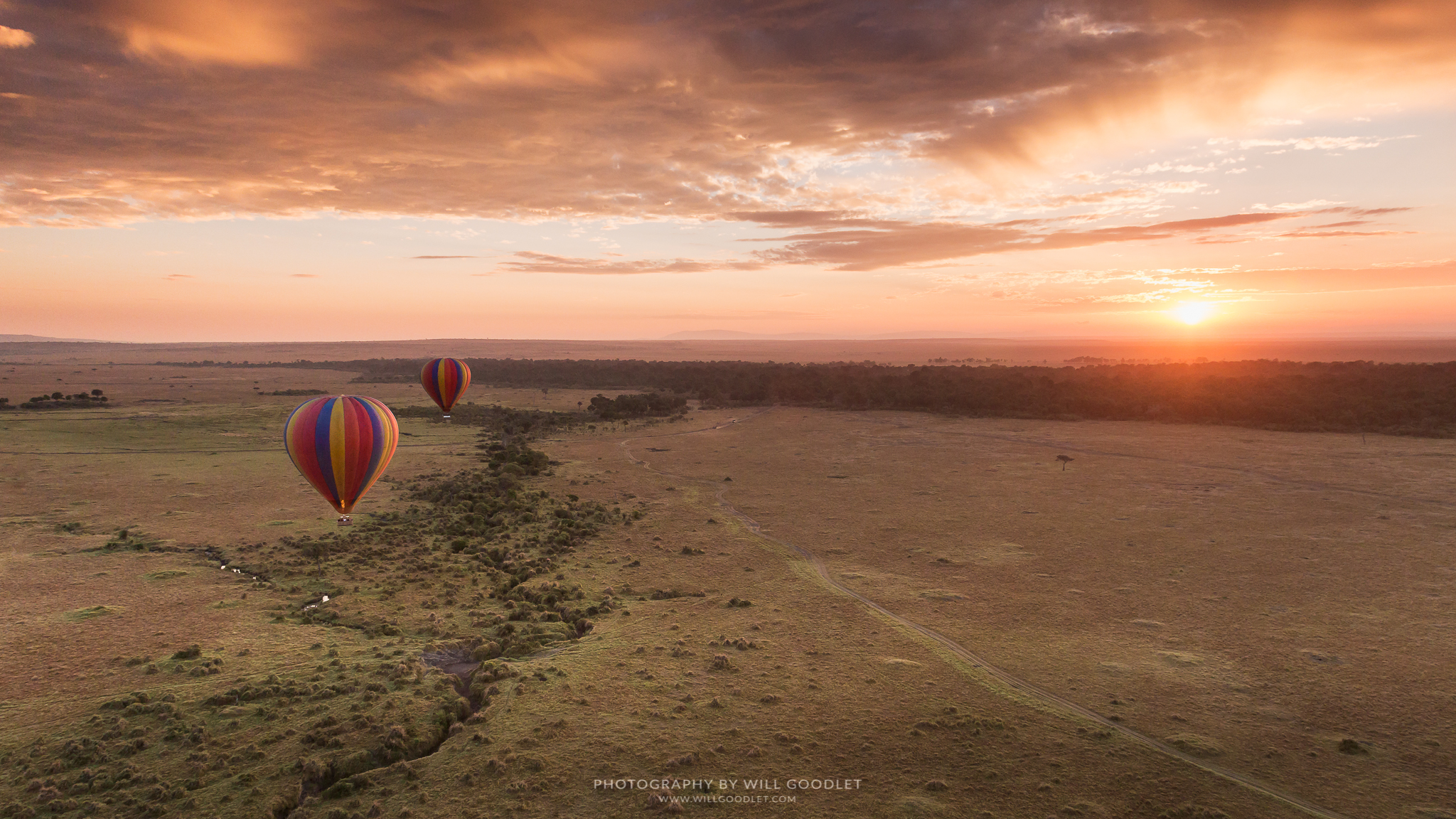 Sunrise photographed from a hot air balloon over the great migration and the Masai Mara, Kenya - Will Goodlet