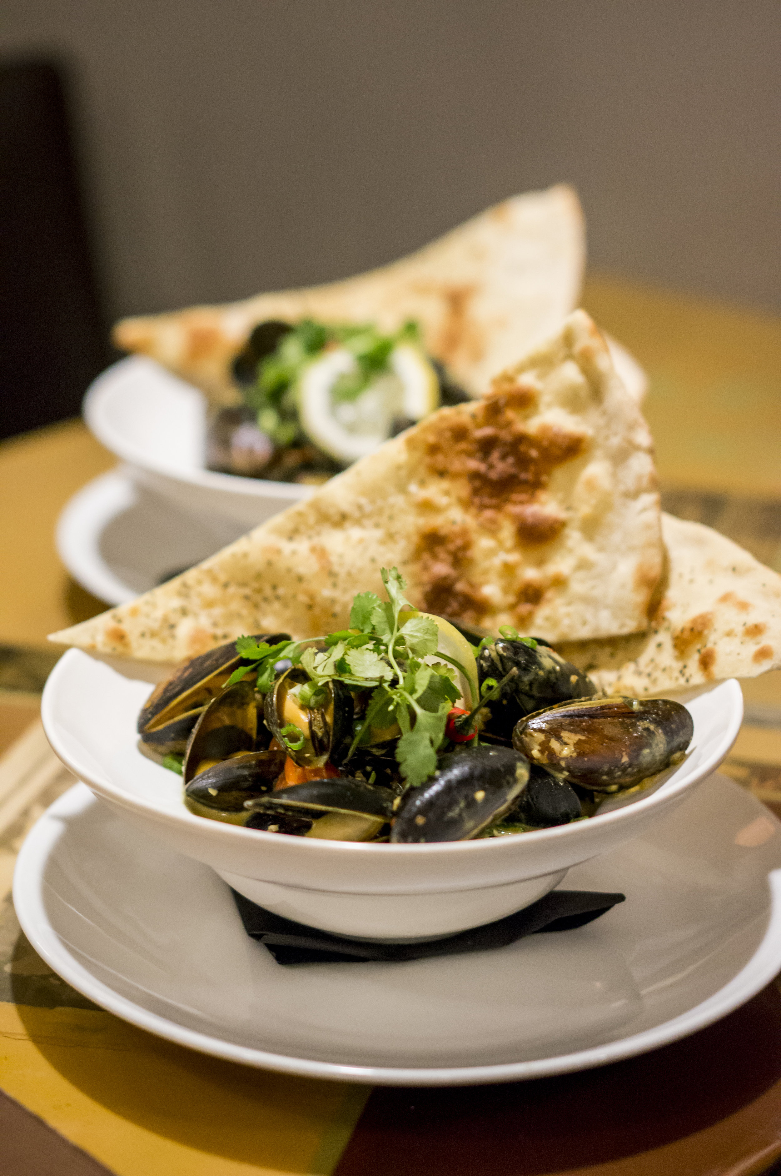 EIGHT 1/2 RESTAURANT  MOUNT PLEASANT 153 E 8TH AVE, VANCOUVER, BC V5T   SPECIALTY MENU ITEM:DELICIOUS MUSSEL HEARTS  FRESH SALT SPRING ISLAND MUSSELS IN WARM CURRY BISQUE WITH HOUSE NAAN.