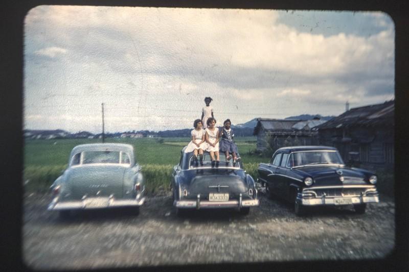 kids on cars.jpg