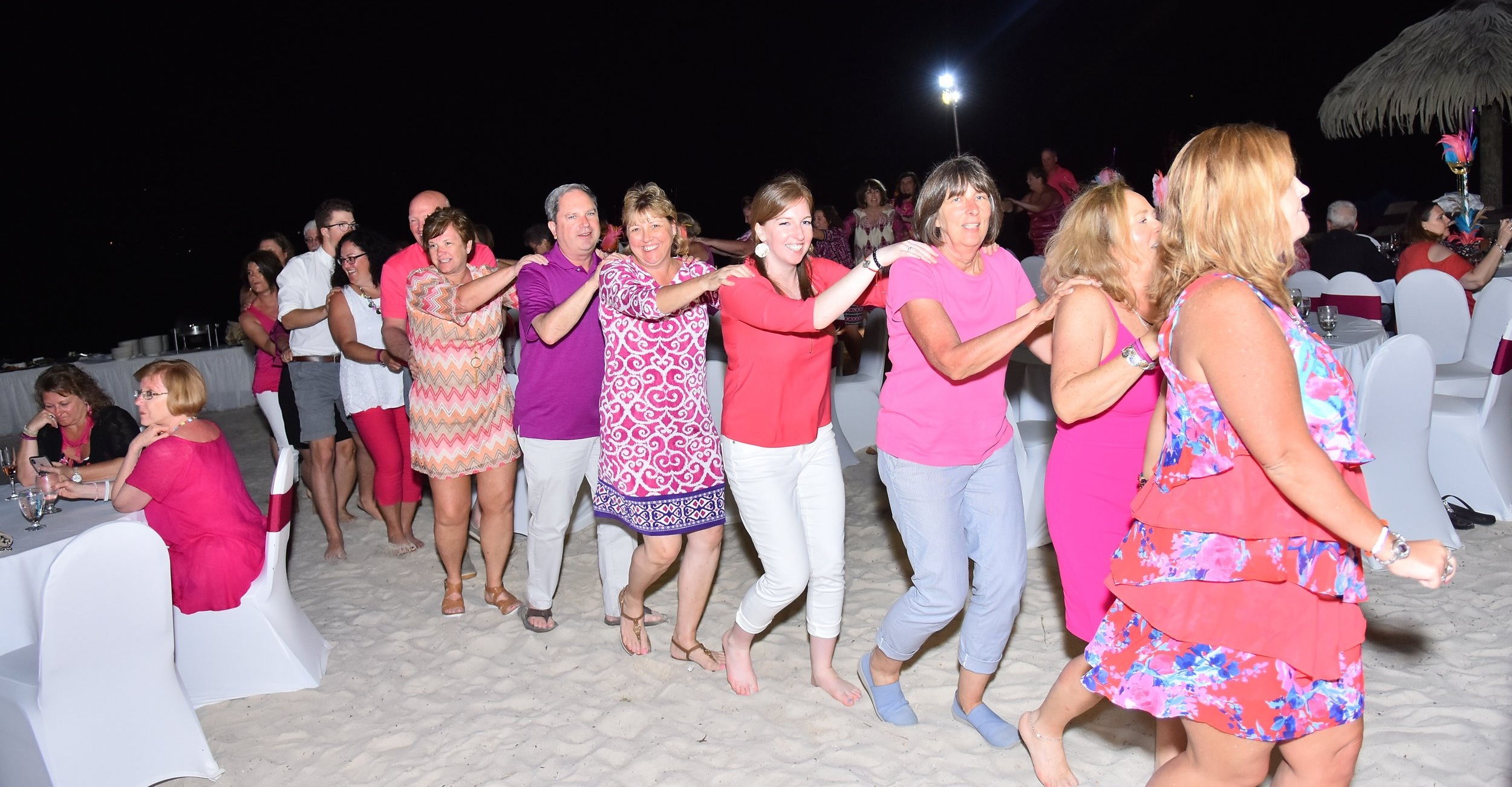 Enjoying a conga line after dinner on the beach