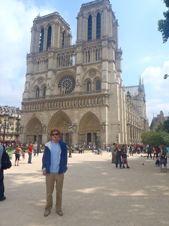 """My digital photos are all I have of that trip."" - Alex Gedeon, posing in front of Notre Dame."