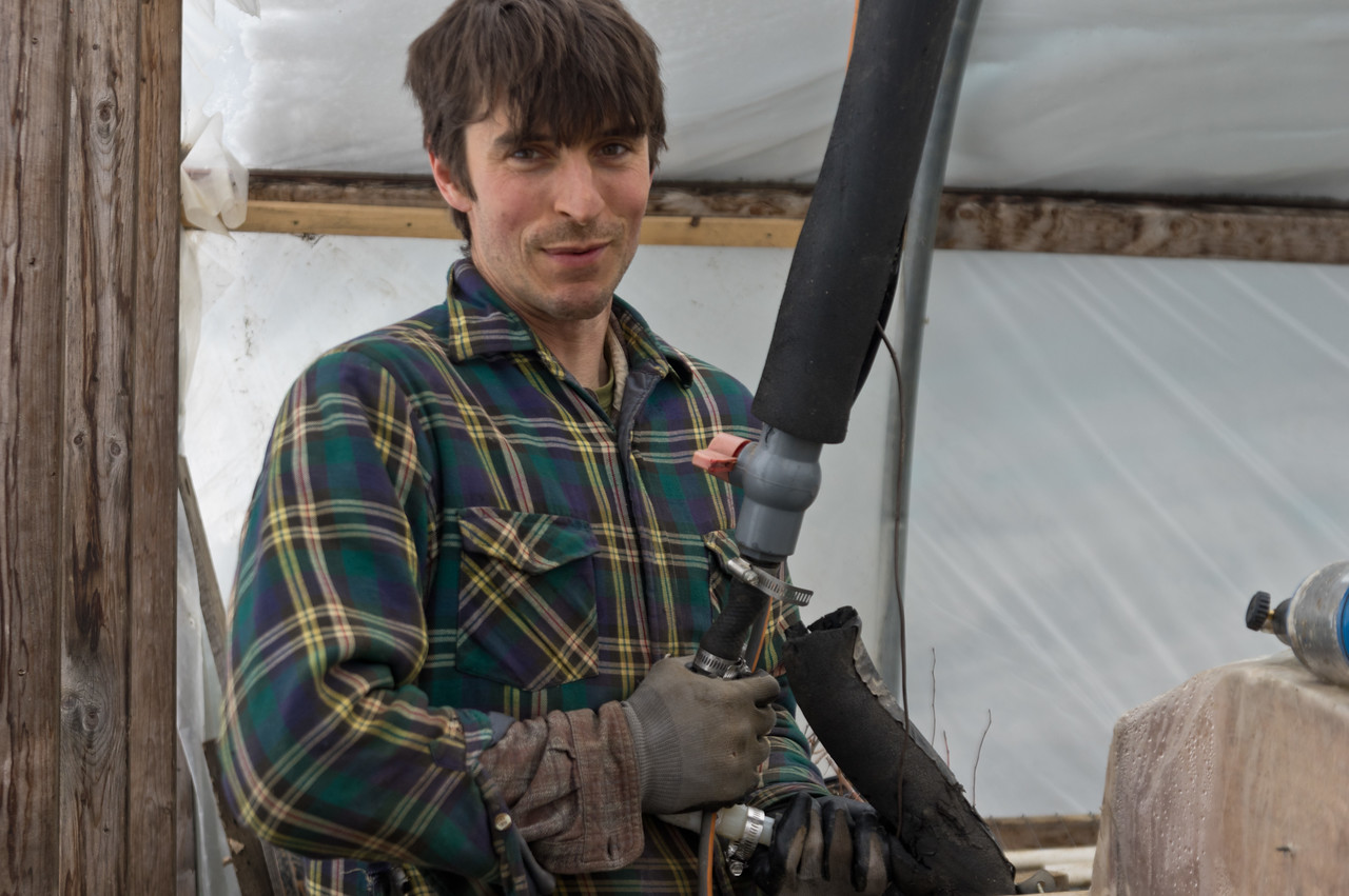 Ryan setting up the plumbing for the hot water bench in the propagation house, photo by Adam Ford.