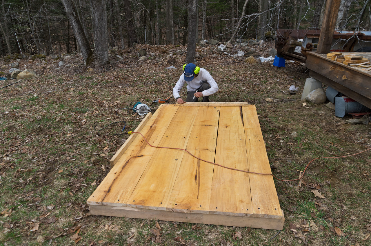 Peter building a new large pallet for the front of our tractor. We use a large platform like this to move around transplants and loaded harvest bins. After a couple years the pallet needs to be rebuilt. Thanks Peter! Photo by Adam Ford