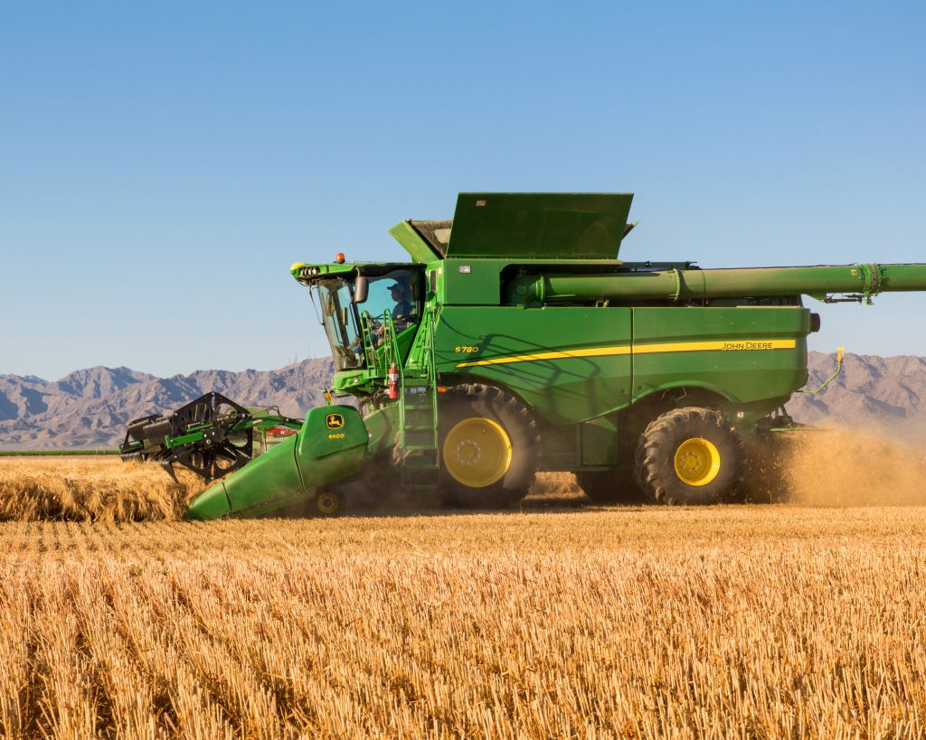 this is a generic image of a combine from machinefinder.com in case you aren't sure how wild they look.. Morgan was driving one that harvested green beans though, not grains.... now she is on a bike:)