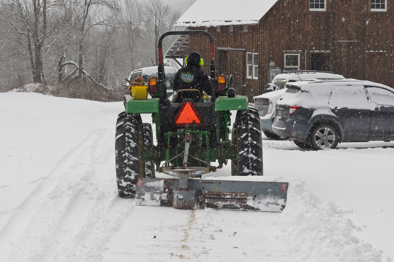 Ryan plowing the driveway, photo by Adam Ford