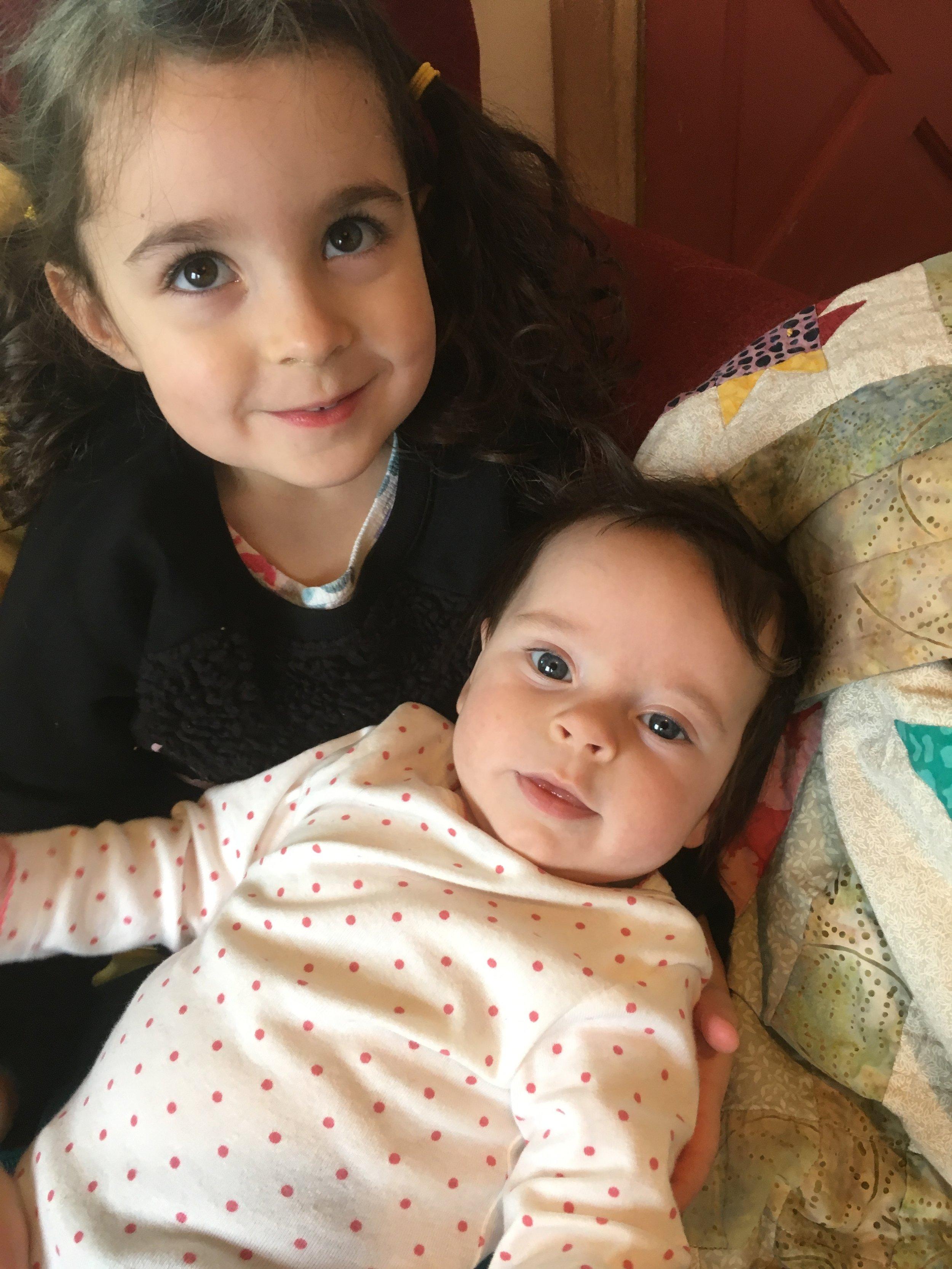 One of Soraya's older cousins, Viola is holding her!