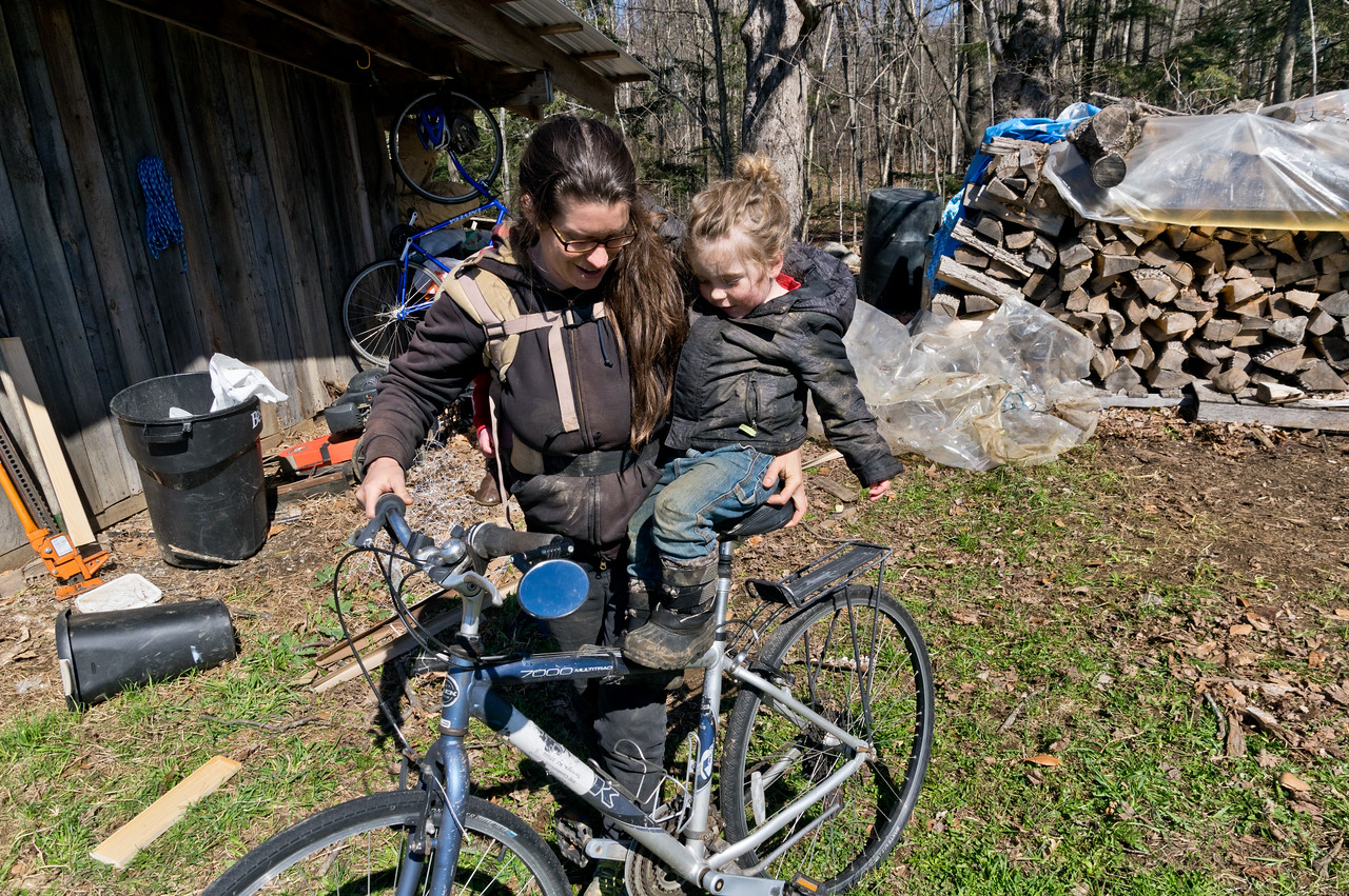 I was telling Sky about how in the future, mama will have to kick her car habit and get back on a bike more, so he wanted to try mama's bike… Soraya was bored about the continued lessons in climate change, so she just snoozed on my back, photo by Adam Ford