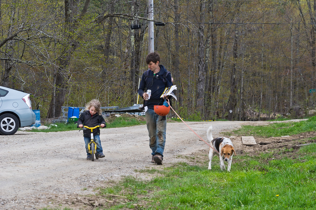 Ry taking the kiddos and dog for a walk (Soraya is hiding on his back), photo by Adam Ford