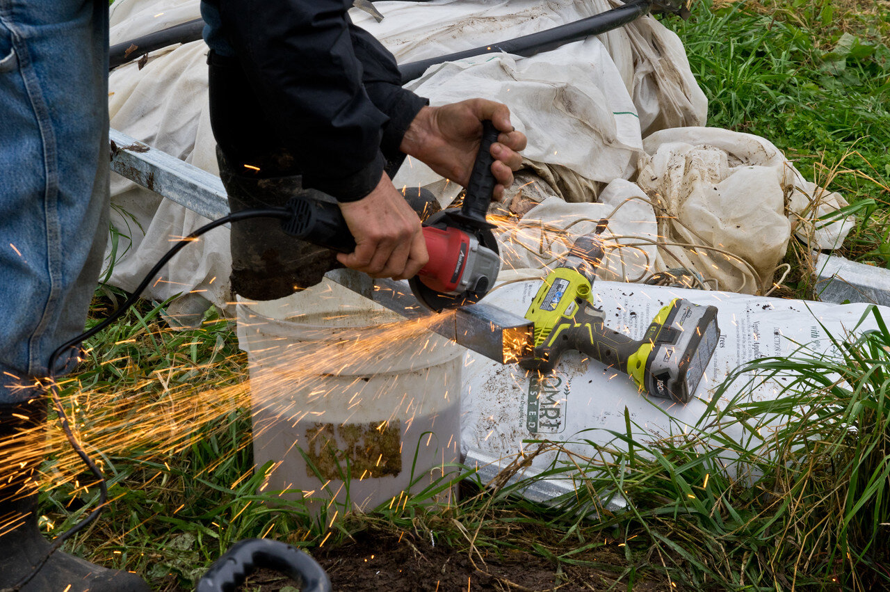 Cindy being the boss that she is, cutting the metal studs for the end walls on the new tunnel, photo by Adam Ford
