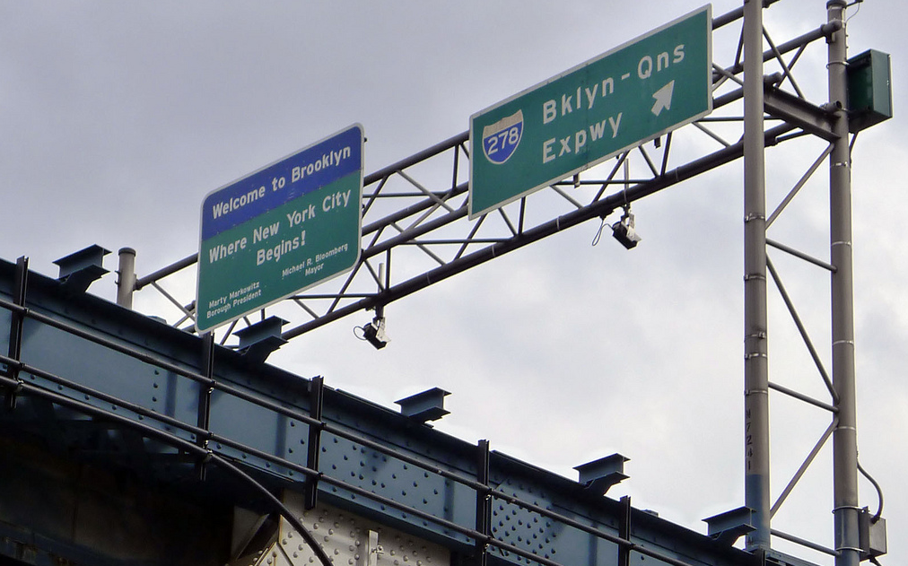 ( source )   A large factor that determines material is strength, for obvious reasons. Permanent traffic signs need to be solid and durable. While achieving strength is possible with both metal and wood, application heavily impacts the determination. For example any signage that is to be hung above or over a highway should use steel structures to support. Other applications where signs are more stationery on the ground, wood is preferred. Wood sign posts are available in various grades and species, which will impact the level of strength. State DOTs often do studies to ensure only the best and most effective grades and species are used. Traditionally Southern Yellow Pine (SYP) has been the top choice as it's the strongest of the softwood species. Red Pine is a good alternative to SYP when needed. Both species can provide the strength that is required for sign posts and are readily available.  When it comes to durability and performance in the long run, wood has some big advantages. Steel is very strong, which might lead people to believe that it would always win in this regard, however steel, even when galvanized, can rust overtime which can compromise its structural integrity. Wood on the other hand is a natural product that, for sign post applications, has been pressure treated to enhance its performance characteristics. Wood weathers well overtime and as a readily renewable resource wood is easier and cheaper to replace, should the need ever arise.