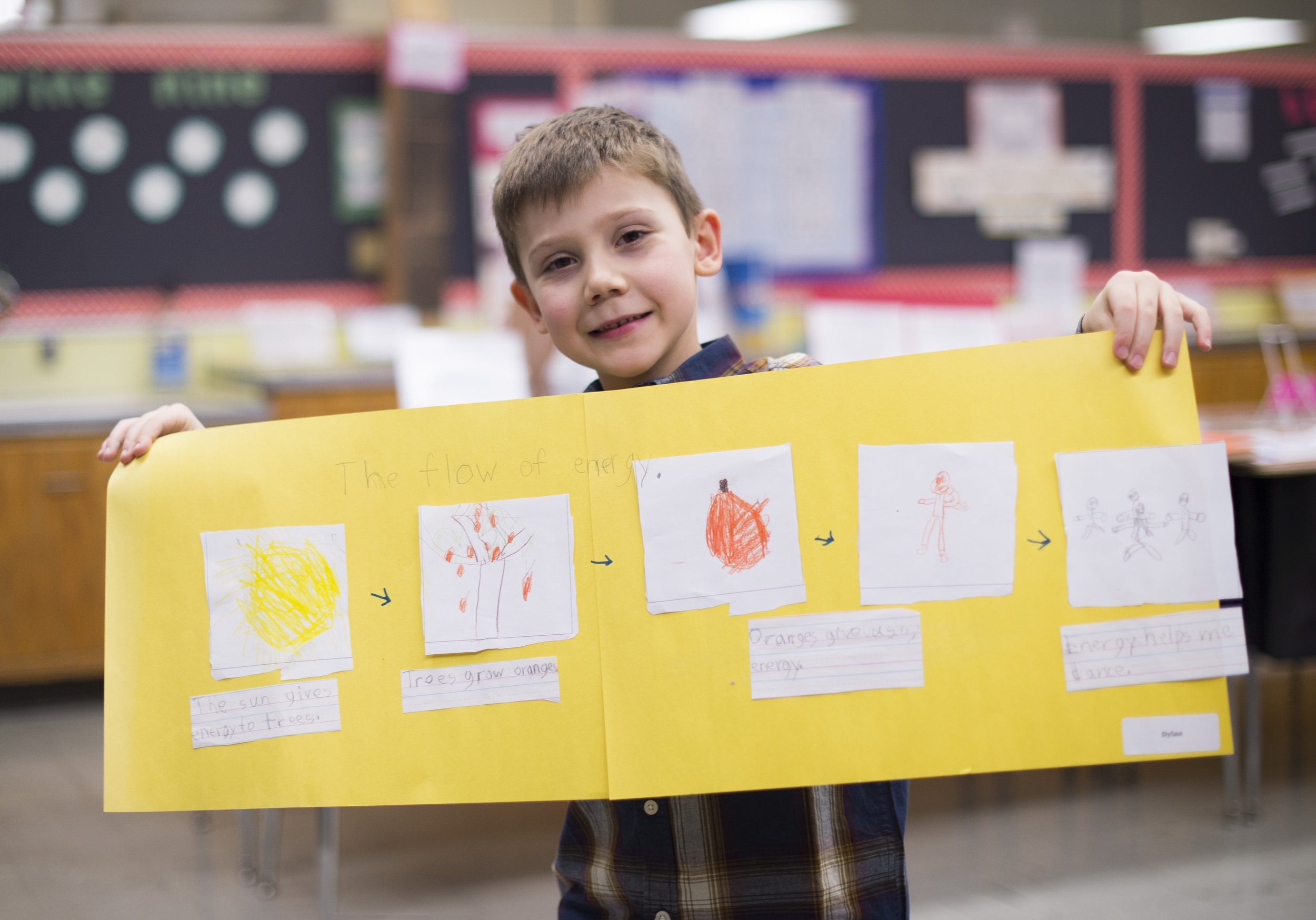 Boy Holding Up Project at Vine Academy Private School