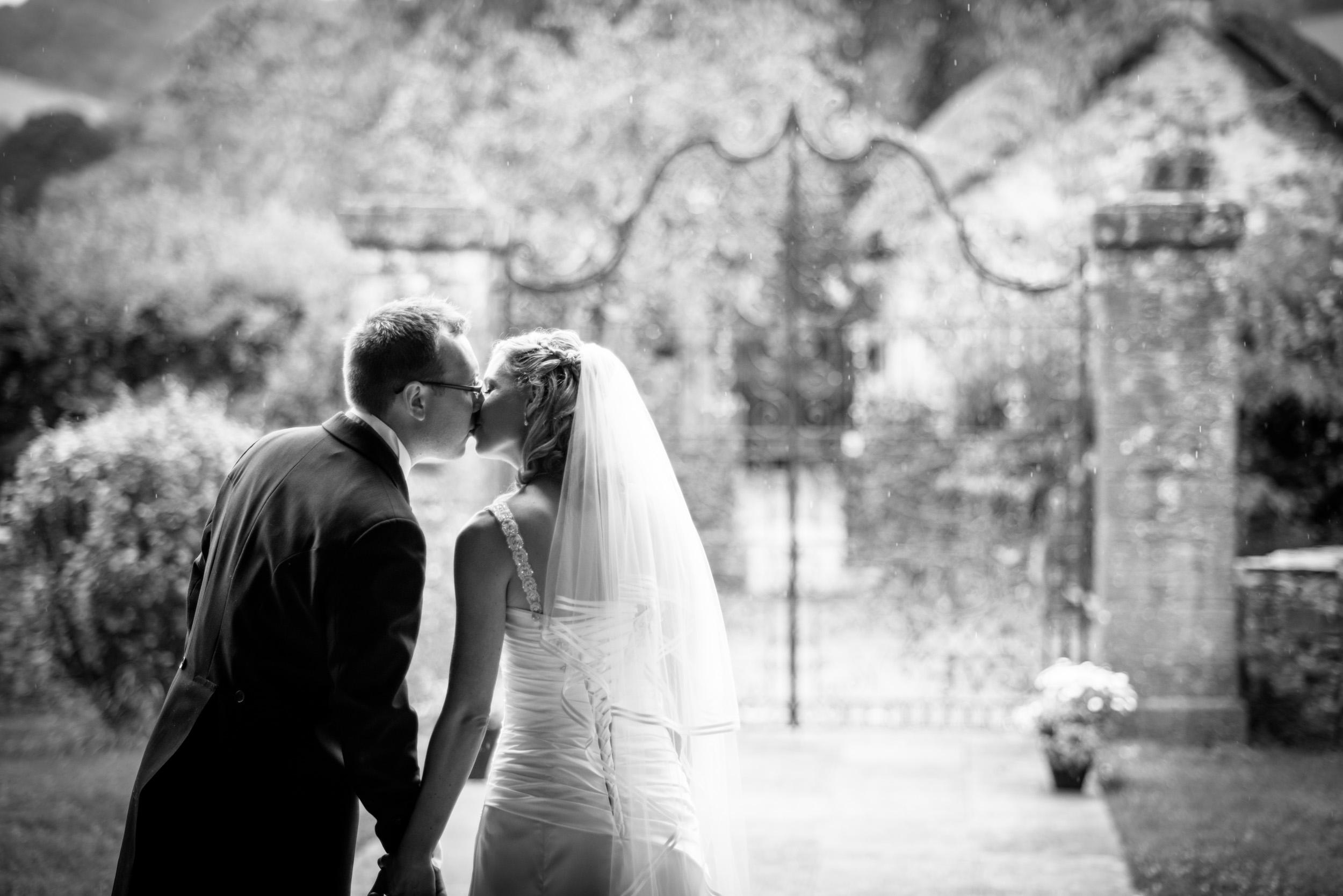 bride-groom-kissing-rain-1.jpg