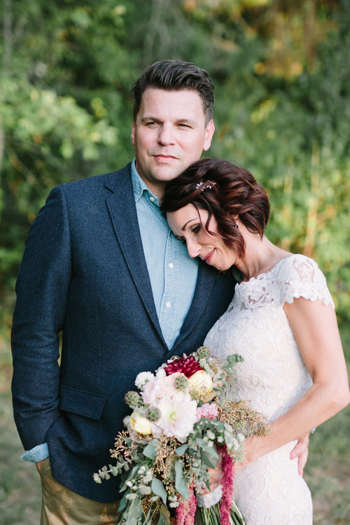 Pictured: Casey and Mark and their boho bouquet. Photo by Dasha Crawford