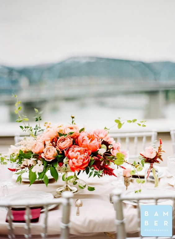 Pictured: stunning centerpiece with Peonies at the Hunter Museum. Photo by Bamber Photography.