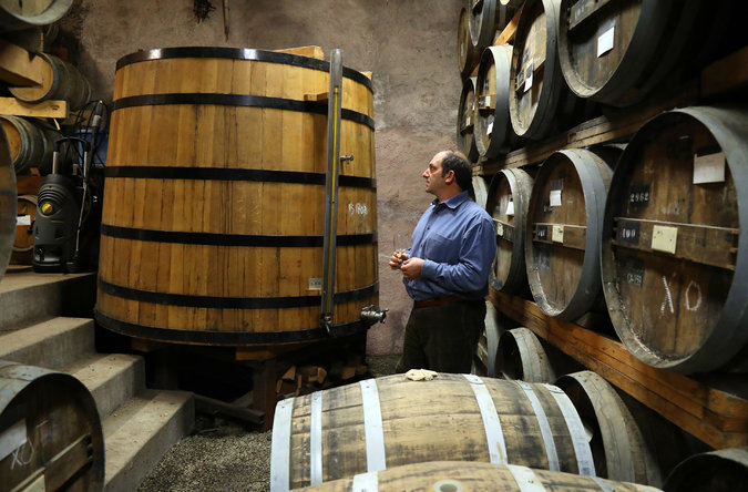 Mr. Farber, in the barrel aging room of his distillery, uses French-built Charentais stills and ages his brandy exclusively in French oak. Credit: Jim Wilson/The New York Times