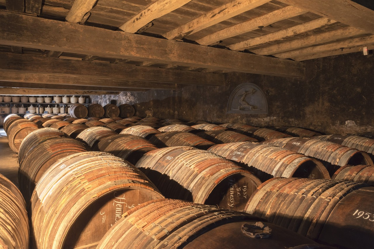 Hennessy storehouses hold barrels of cognac that are decades old. Some barrels date back to the early 1800s.  JULIEN FERNANDEZ FOR THE WALL STREET JOURNAL