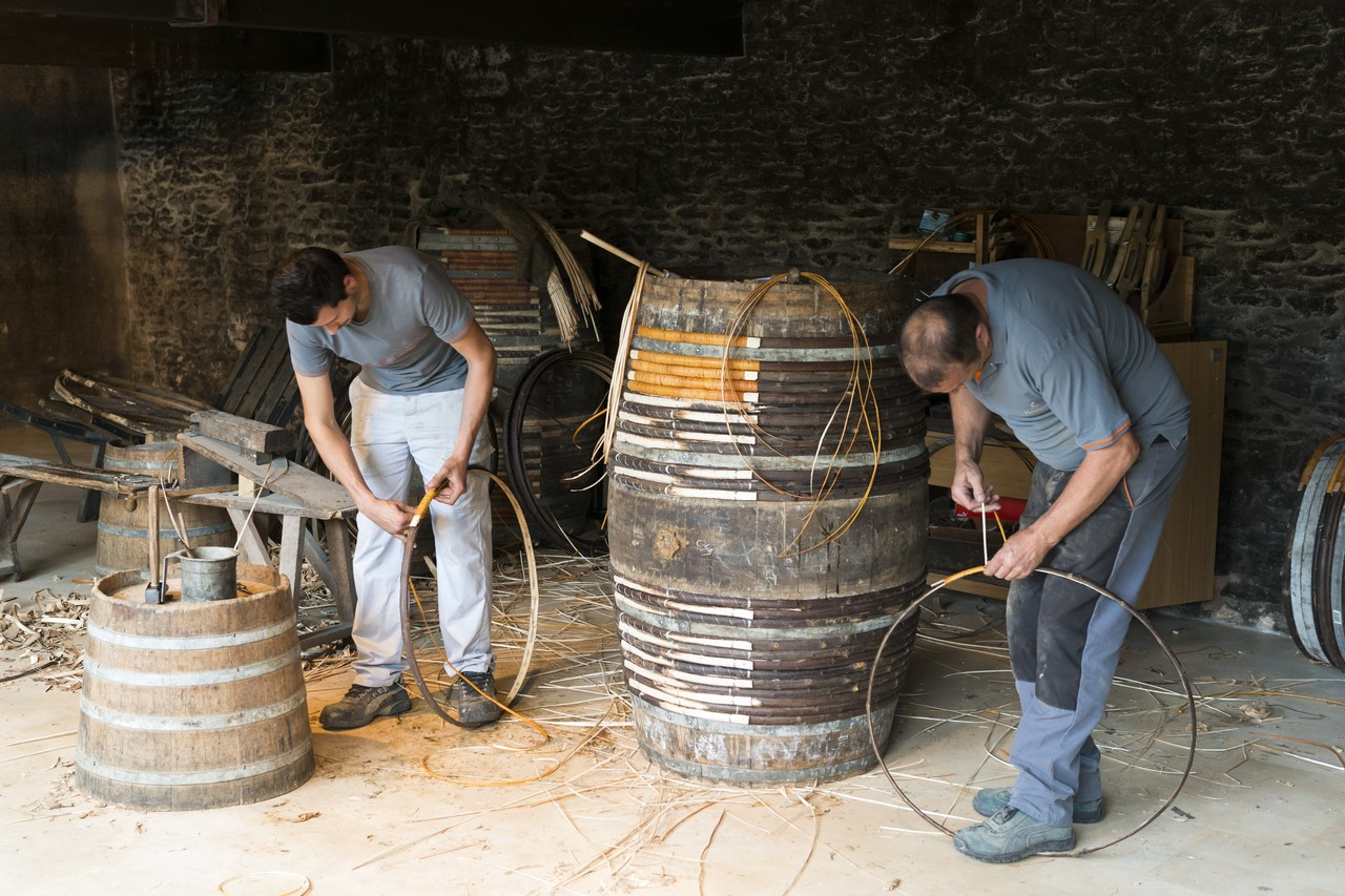 Most of the barrels Hennessy uses to age cognac are machine-made, but the company still employs people who know how to make the barrels by hand.  JULIEN FERNANDEZ FOR THE WALL STREET JOURNAL