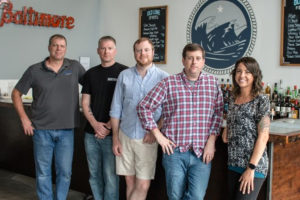 Mark McLaughlin, center, with the Old Line Spirits team.