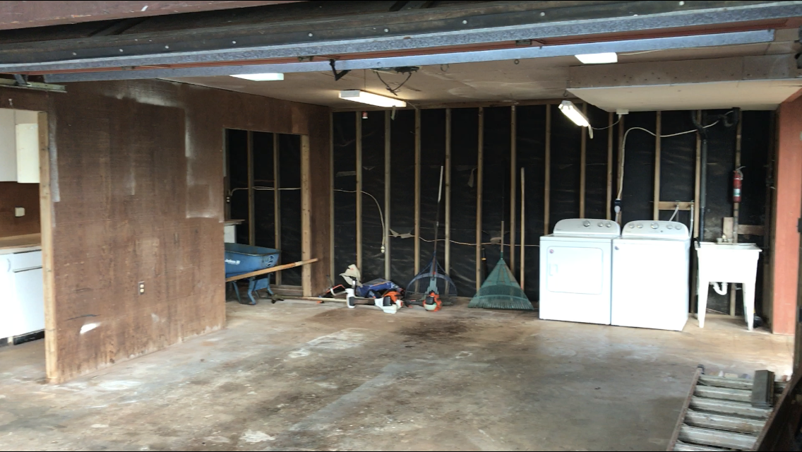 Here is the garage before we moved in. Not a lot of creative energy going on so it needed a revamp.