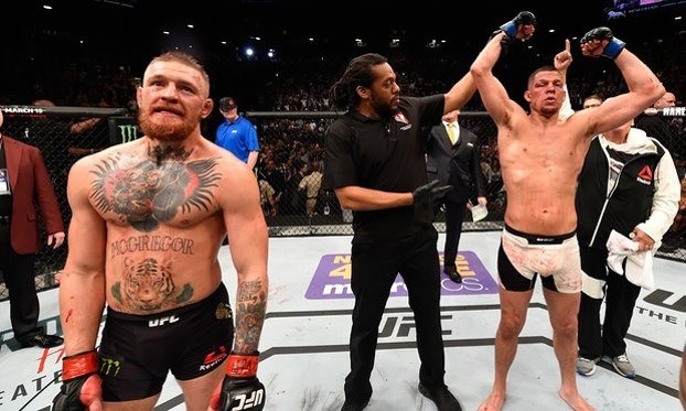 A devastated McGregor with an 'unsurprised' Diaz
