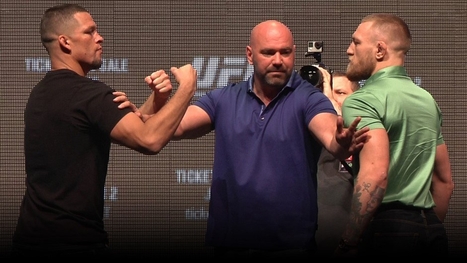 Diaz and McGregor squaring off at a press conference for UFC 202