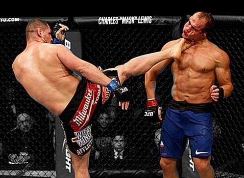 Too much damage: Junior Dos Santos (right) has not looked the same since his bouts with Cain Velasquez (left)