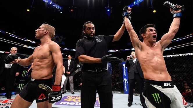 One of a kind   – Dominick Cruz (right) reclaiming his belt against TJ Dillashaw