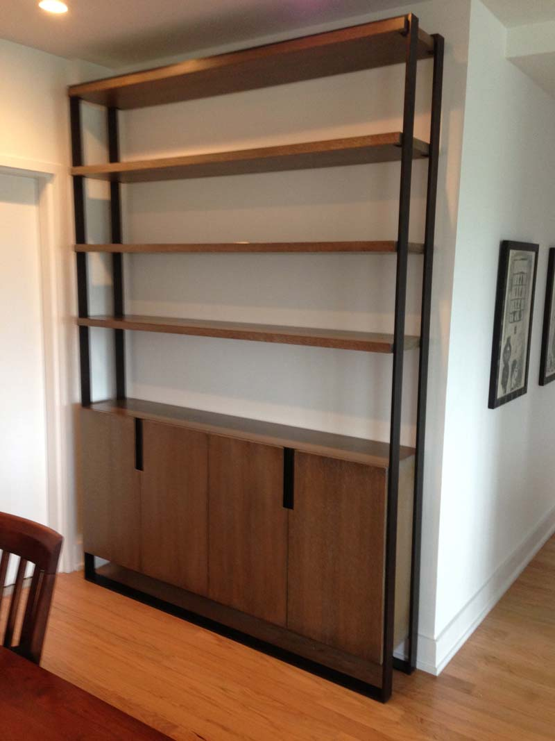 Oak & Steel Bookcase   Rift sawn white oak bookcase with cerused finished and black patinated steel frame with steel backed finished pulls.