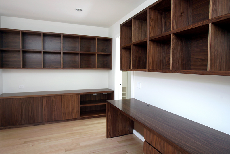 Mohawk Study   Flat cut walnut cabinets with integrated finger pulls, bookcases in natural lacquer finish.