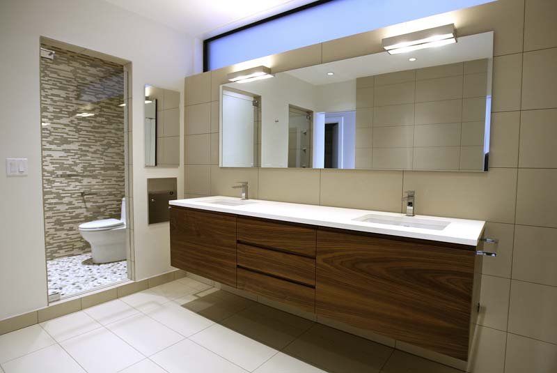 Mohawk Vanities  Flat cut walnut vanities with integrated finger pulls, natural lacquer finish.