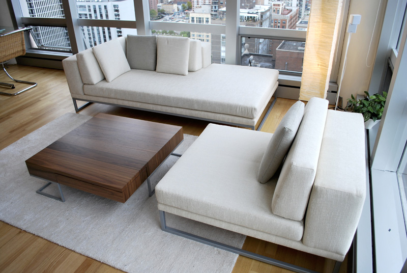 Astor Place Furniture   Powder coated steel and walnut veneered coffee table. Upholstered sofas with Powder-coated legs.