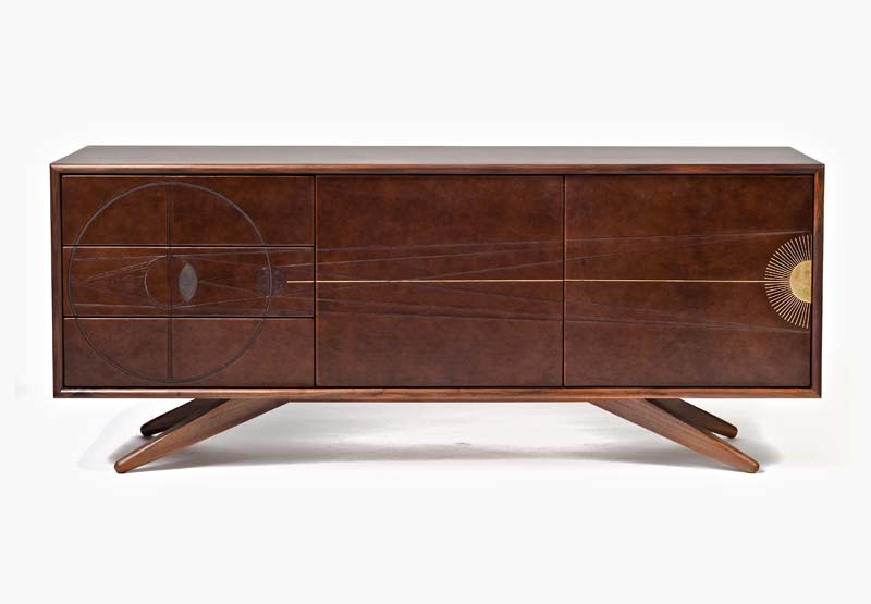 Eclipse Console   Solid quarter sawn walnut console with hand tooled leather doors and drawer faces and gold leaf detail.