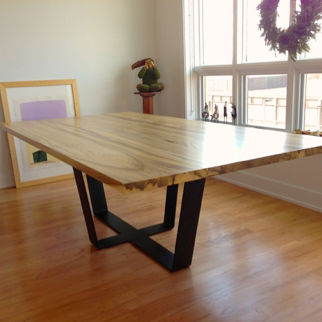Reclaimed Hackberry Dining Table   Hackberry lumber top with natural lacquer finish and black patinated steel base.