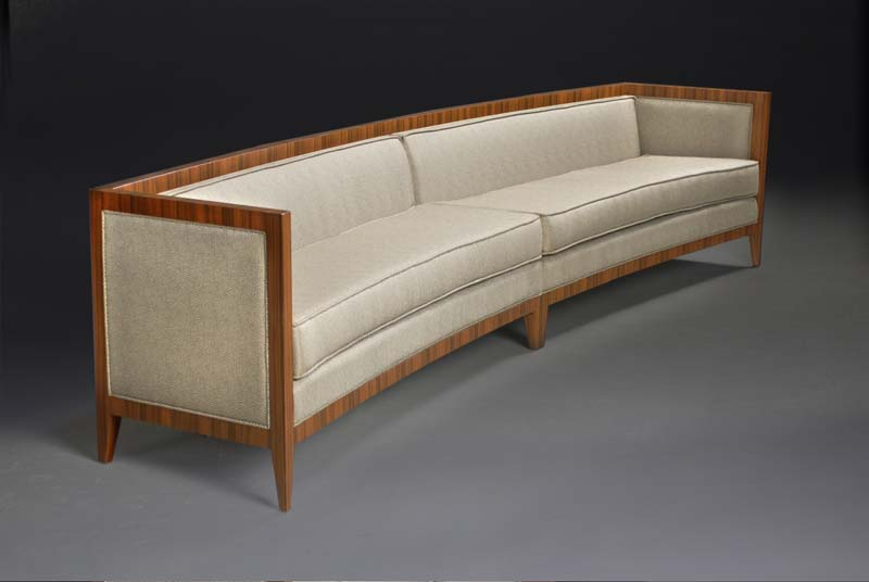 Rosewood Sofa   Santo Rosewood veneered curved sofa with silk upholstery .