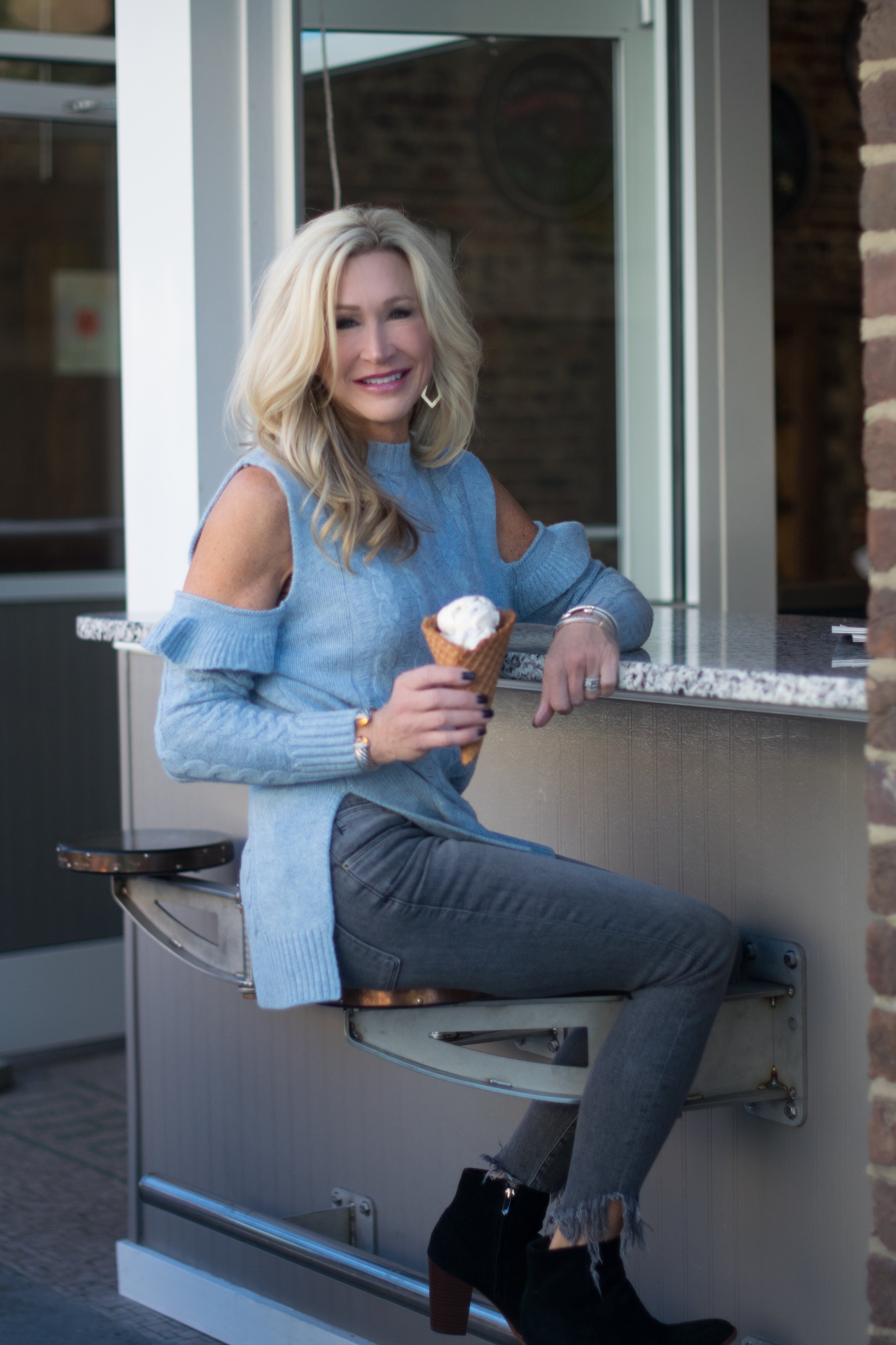 Cold Shoulder sweater and frayed jeans