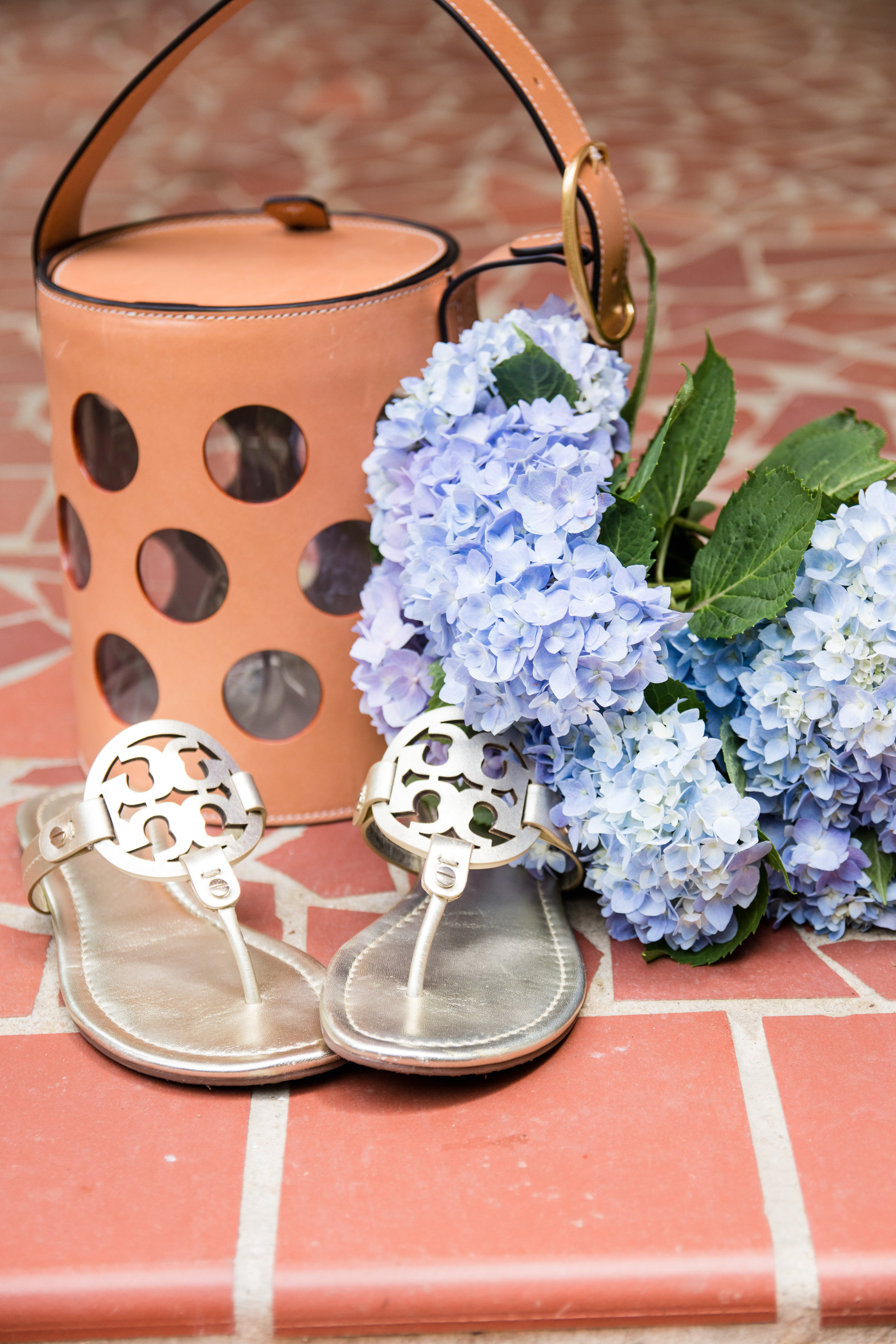 Tory Burch bucket bag and Miller gold sandals