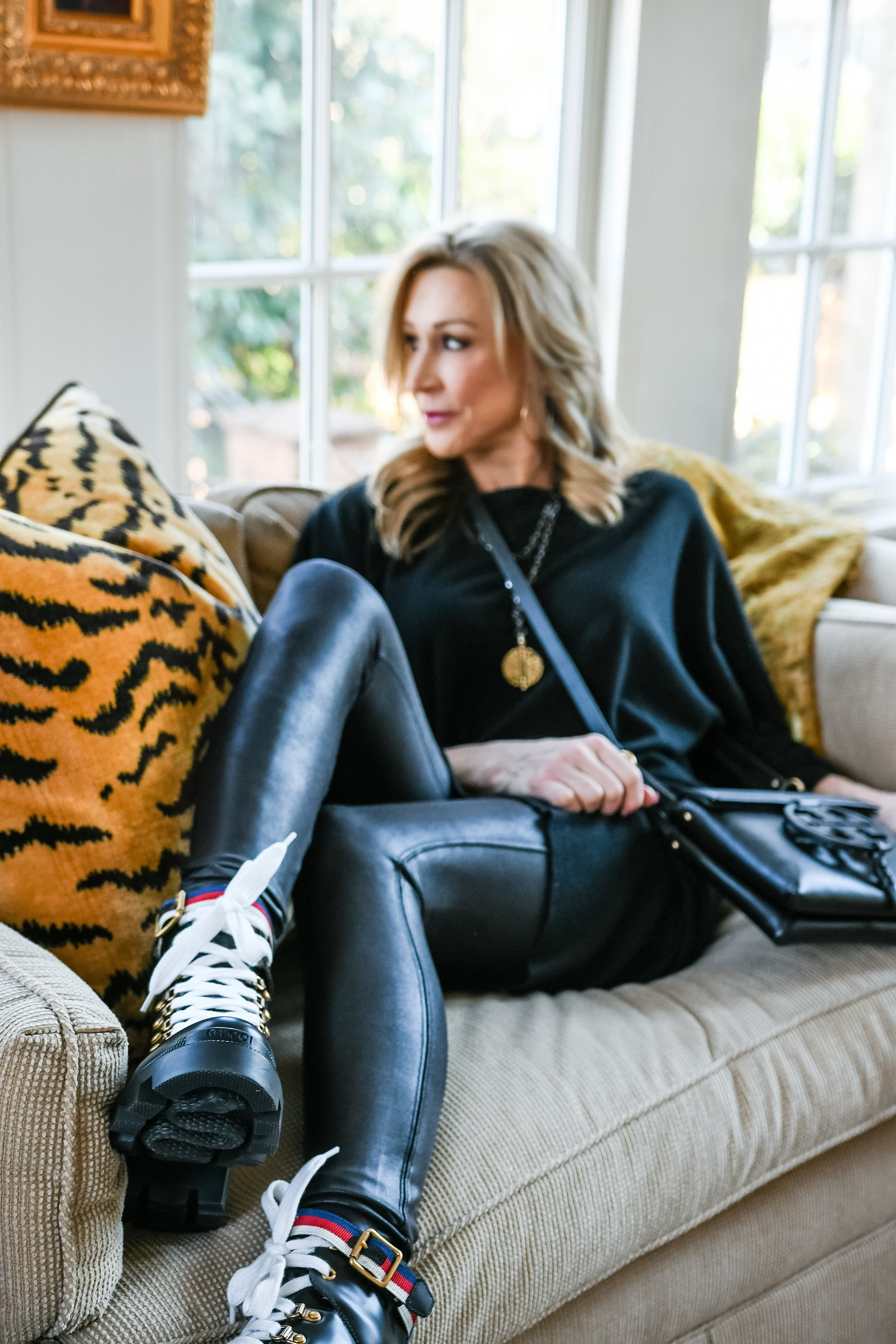 Spanx leggings and sweater dress with Gucci combat boots