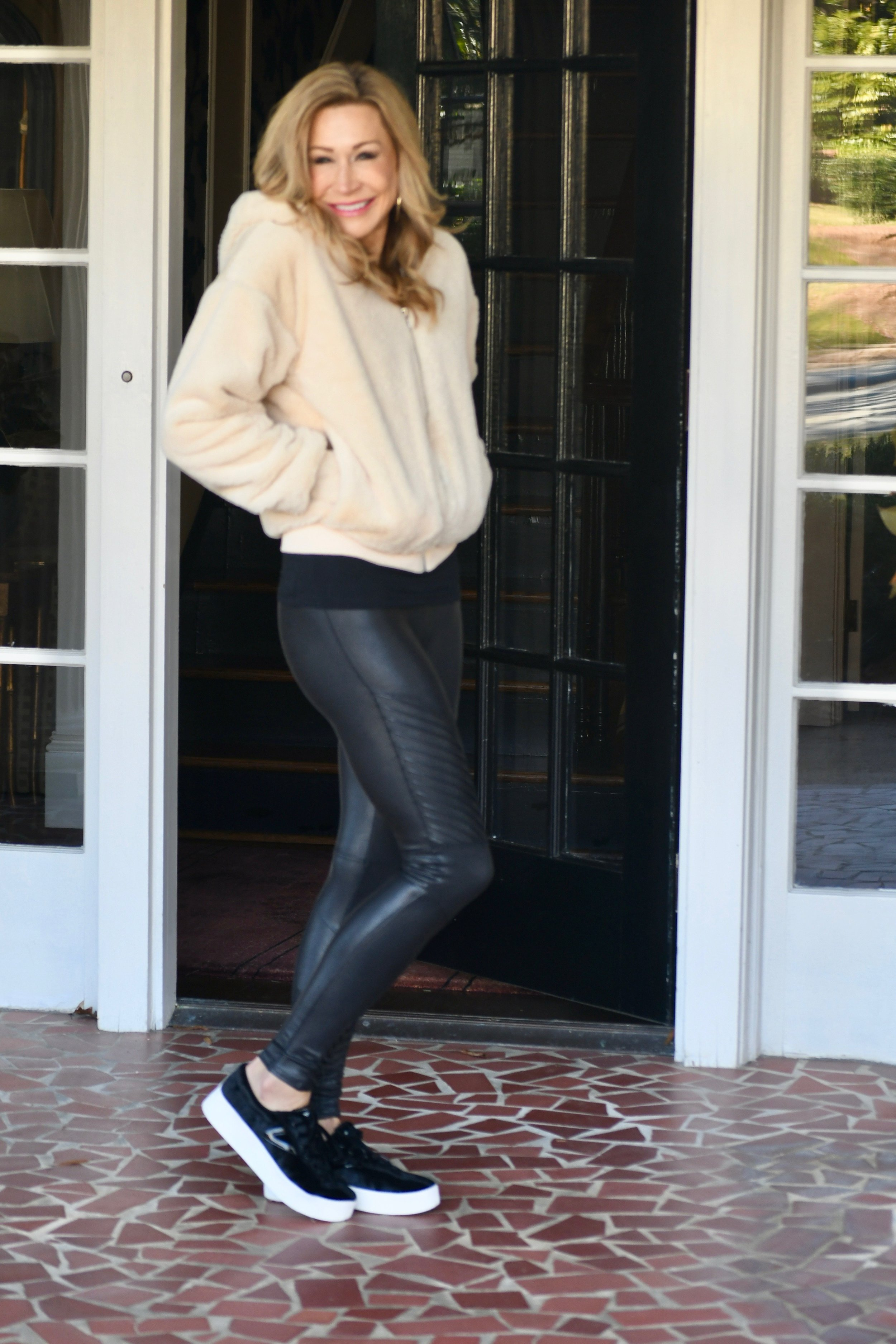 Spanx moto leggings with TopShop jacket and Tretorn sneakers