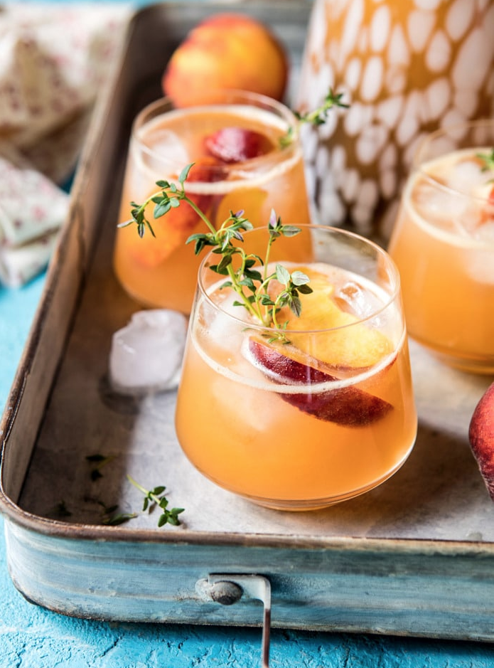 Sweet Bourbon Peach Lemonade via Half Baked Harvest