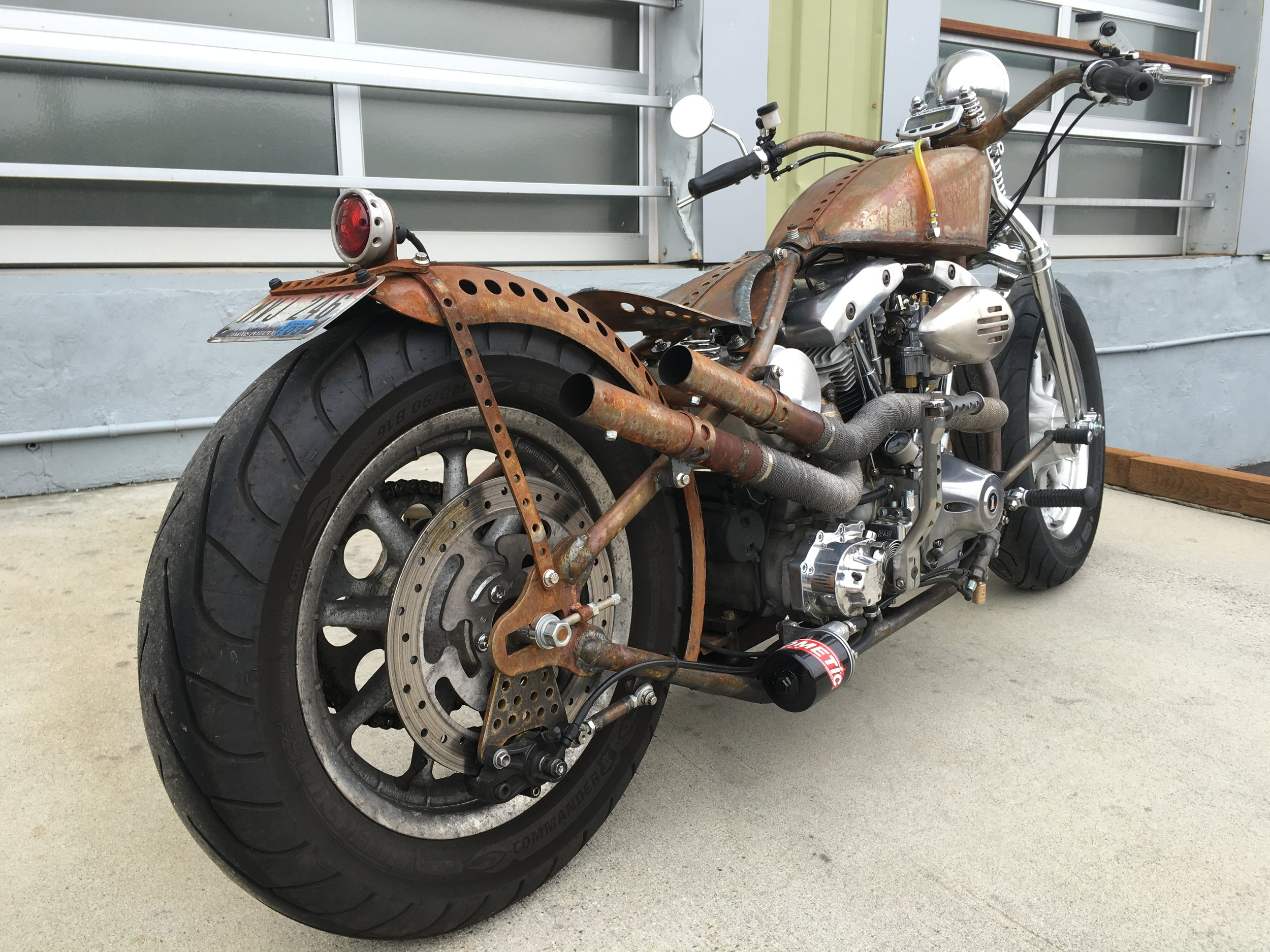 HAND BUILT FENDER STRUT, BRAKE MOUNT AND BRACKET, EXHAUST, SEAT AND HANDLEBARS BY TODD APPLE